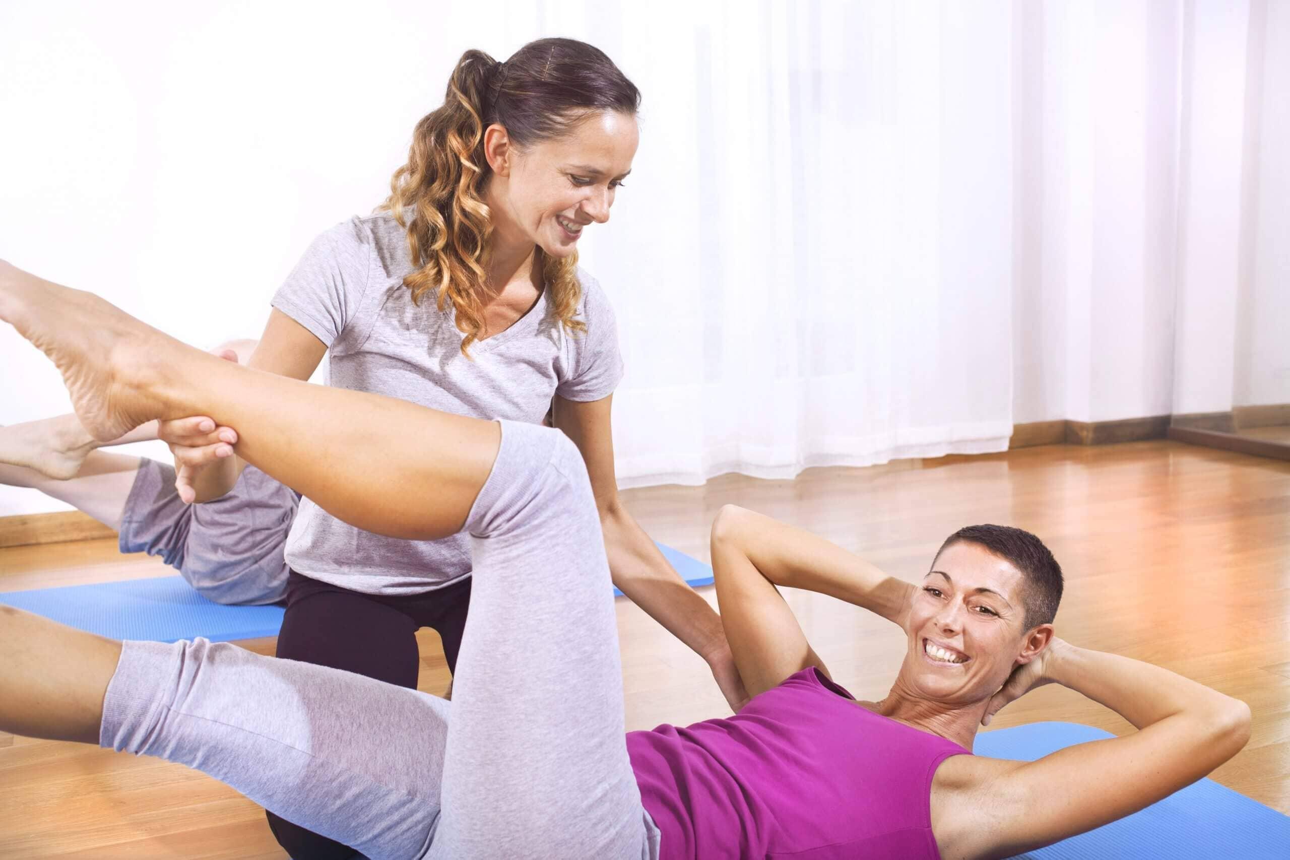 teacher explaining woman fitness exercises